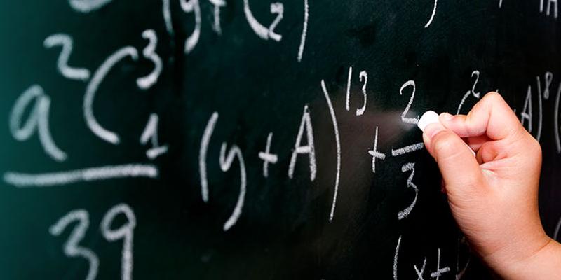Formulas on a chalkboard